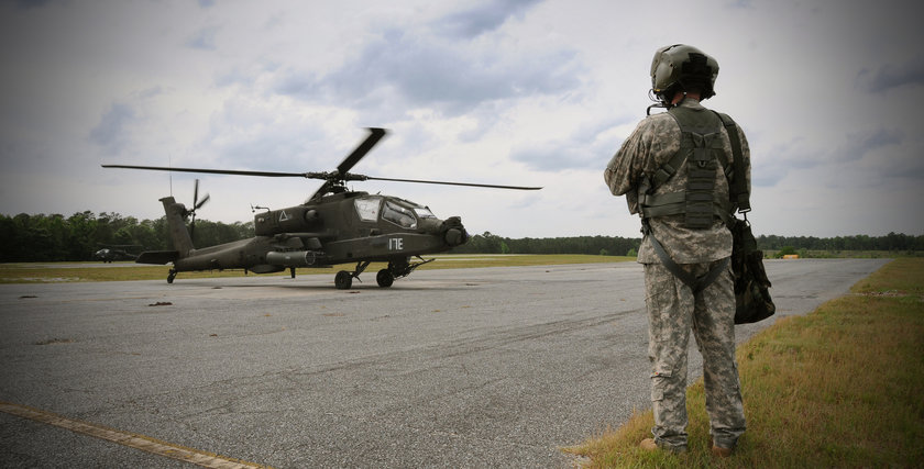 WO1 Dan Kennedy, a flight student assigned to B Co. 1st Battalion, 145th Aviation Regiment, waits for a thumbs up from his instructor pilot to approach the AH-64D Apache helicopter on which he will train May 22, 2013. Photo c/o Fort Rucker