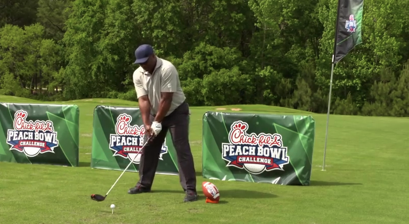 Bo Jackson lines for a drive at the Chick-Fil-A Peach Bowl Challenge. (Photo via YouTube)
