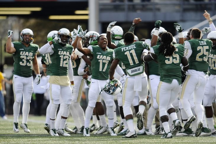 UAB Football Team celebrates early in the 2014 season (Photo: Shanna Lockwood)