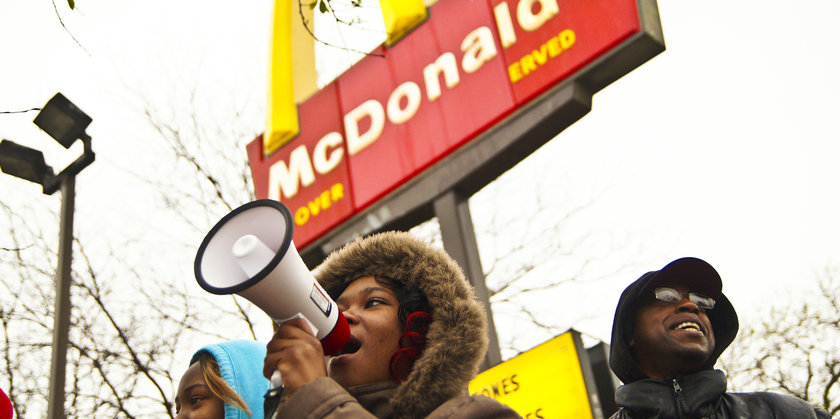 Fast food workers protest McDonald's, push for higher minimum wage. (Flickr user Light Brigading)