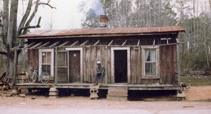 A man sits on his front porch in Selma, Alabama, (Photo: Joe Edmundite)