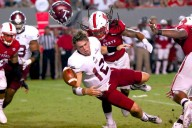 Dravious Wright (8) knocks the helmet off of Brandon Silvers (12) and forces a fumble. NC State defeated Troy, 49-21, on September 5, 2015 at Carter-Finley Stadium in Raleigh, North Carolina. (Photo by: Jerome Carpenter)
