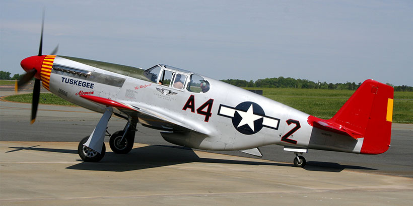 "The ""Tuskegee Airmen"" P-51C Mustang with its distinctive Red Tail (Wikimedia commons)"