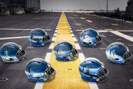Hand-painted 2015 Navy football helmets for the Army-Navy game. (Photo: Navy football)