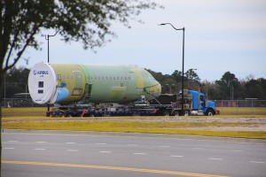 A fuselage section is transported to Airbus' assembly facility in Mobile. (Image: Roger Wehner, Mobile Airport Authority)