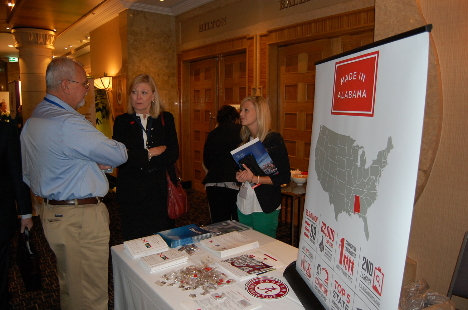 Commerce's Hilda Lockhart, center, chats at the Made In Alabama booth at the 2015 Trade Winds conference in South Africa.