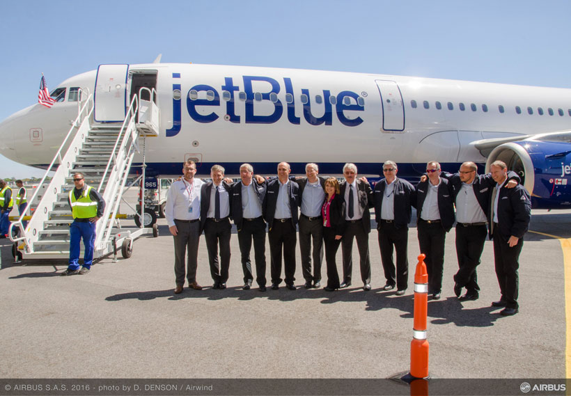The flight crew of the JetBlue A321 pose for a picture after completing the plane's initial flight test. (Image: Airwind via Airbus)