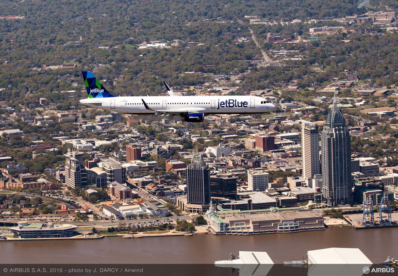 The first Alabama-made A321, sporting JetBlue livery, cruises over Mobile on its initial test flight. (Image: Airwind via Airbus)