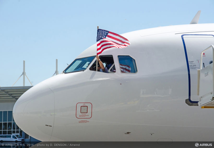 A U.S. flag waves from the cockpit of the first Alabama-made Airbus A321 after the test pilots complete the plane's maiden flight. (Image: Airwind via Airbus)