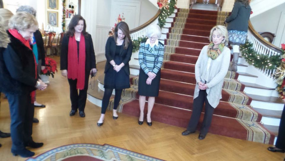 Dianne Bentley and guests at the Governor's Mansion bow their heads in prayer. (Photo: Murial Farley)