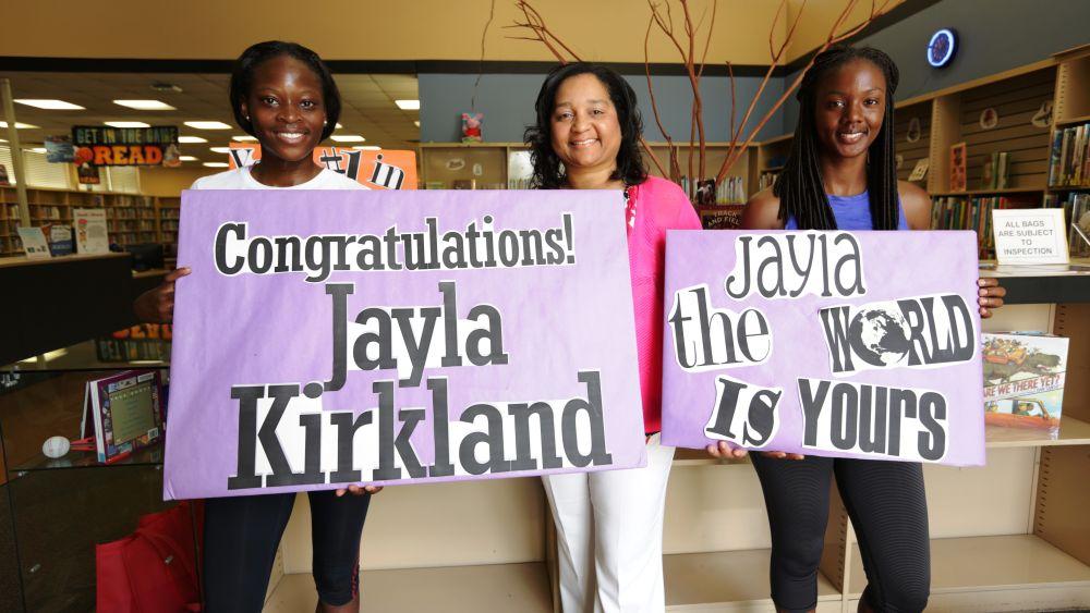 Jayla Kirkland (left) is joined by her coach Myra Hawkins (far right)