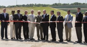Gov. Robert Bentley is joined by elected officials and business leaders to cut the ribbon on Interstate 22. (Christopher Jones/Alabama NewsCenter)