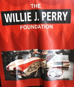 A banner for the Willie J. Perry Foundation displays a photo of Perry's signature ride, the Rescue Ship. (Solomon Crenshaw Jr./Alabama NewsCenter)
