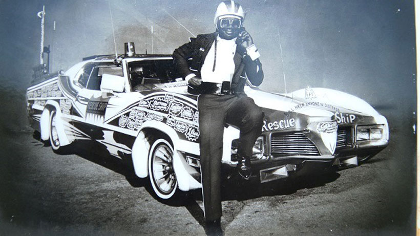 """A photo on Willie J. Perry's tombstone shows him in crusading mode as """"Birmingham's Batman"""" with his Rescue Ship. (Contributed)"""
