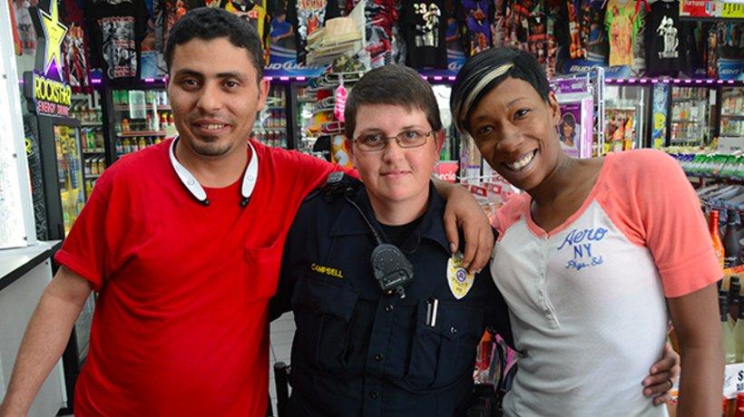 Birmingham Police Officer Heather Campbell with Waleed Senan, left, and Crystal Phillips at the Ensley Shell. (Photo: Karim Shamsi-Basha)