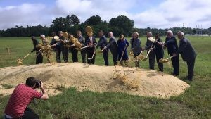 Officials move dirt at the Gerhardi groundbreaking ceremony. (Image: Alabama NewsCenter)