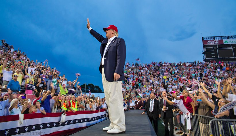 Donald J. Trump waves to a crowd of tens of thousands in Mobile, Alabama. (Photo: Julie Dermansky)