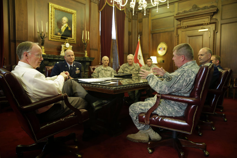 Alabama Gov. Robert Bentley listens to Maj. Gen. Perry Smith, Adjutant General of the Alabama National Guard, during a briefing with Alabama National Guard officers at his Capitol office on Monday, March 10, 2014. (Photo: Governor's Office)