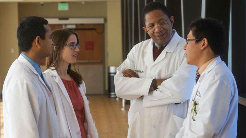 Dr. Selwyn Vickers, Senior VP, Medicine, and Dean, School of Medicine, talks to several medical students. (file)