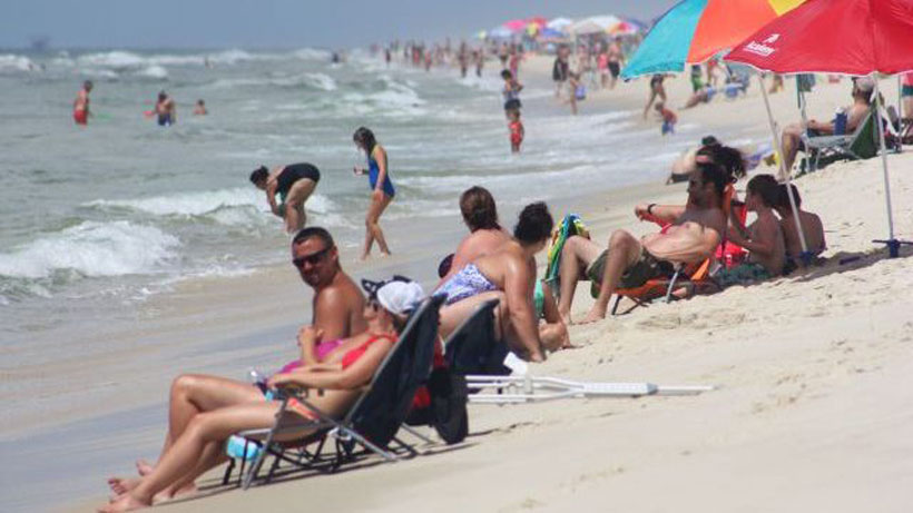 Tourists enjoy the beaches at Fort Morgan during the last week of July. Summer rentals have set records each year for the past five years and appear to be on a record-setting pace this year. (Robert DeWitt/Alabama NewsCenter)