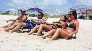 John Kemper of Fairhope, Mike Robichaux and Ali Robichaux of Ruston, La. and Trinity Stanley of Homer, La. relax at Fort Morgan. Tourists have come back in record numbers since the 2010 oil spill. (Robert DeWitt/Alabama NewsCenter)