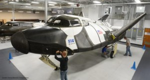Technicians inspect the Dream Chaser spaceplane. (Image: Sierra Nevada Corp.)