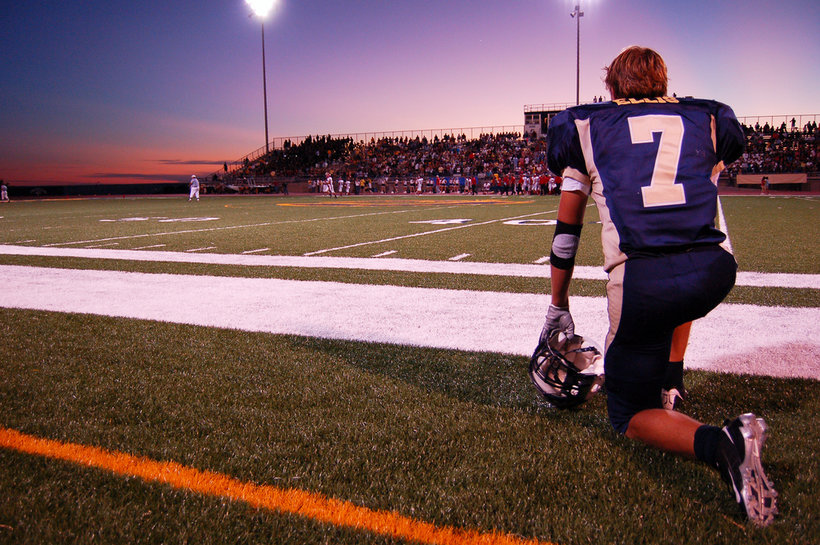 A high school football player watches from the sideline (Photo: Wikipedia)