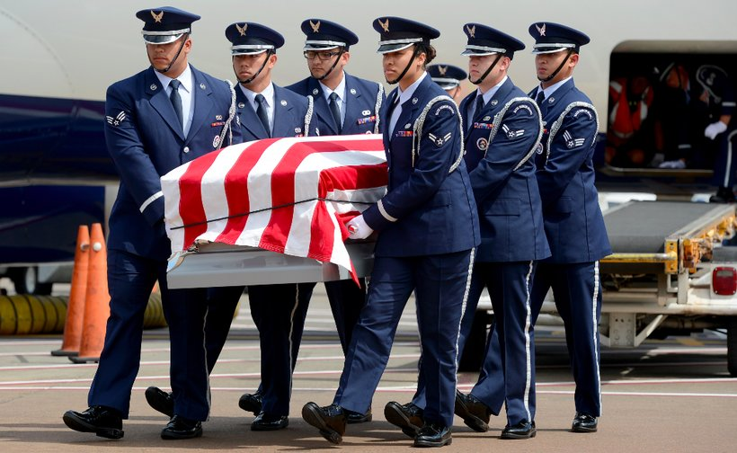 Members from the McChord Field Honor Guard pallbearer team carry a casket to a hearse. (U.S. Air Force photo/Airman 1st Class Keoni Chavarria)