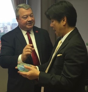 During a visit to Honda's headquarters in Tokyo, Commerce Sec. Greg Canfield presented a glass sculpture from Alabama's Orbix Hot Glass as a gift.