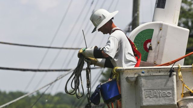 Lineman works to restore outages after storm damage in Hoover. (file)