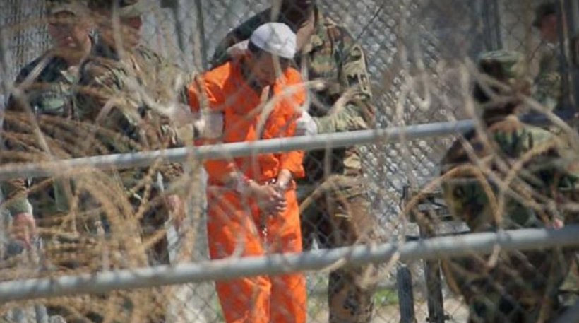 A detainee being moved at Guantanamo Bay Prison. (Photo: Screenshot)