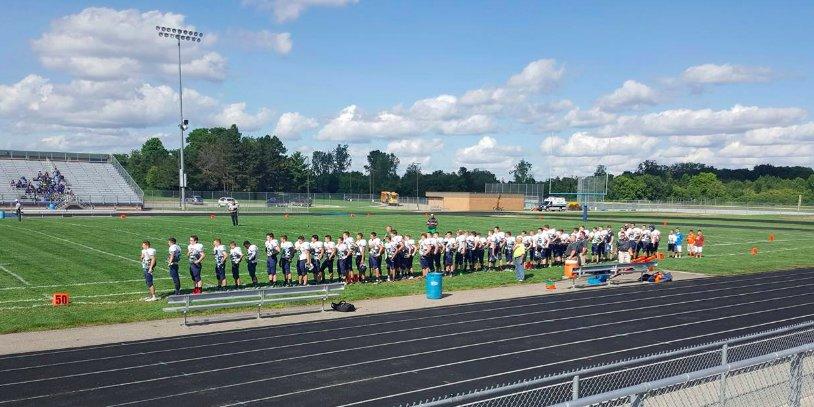 The Lapeer High School freshman football team sings the National Anthem. (Photo: Michelle Byrnes)