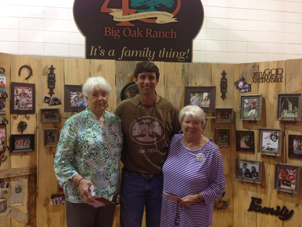 Mama B (pictured right) with Brodie Croyle (center)
