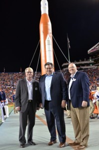 The halftime show during Auburn's football game against Arkansas featured a tribute to NASA. Pictured, from left, are Mike Ogles of Auburn University's Huntsville Research Center; Todd May, director of the NASA Marshall Space Flight Center; and Chris Roberts, dean of Auburn's Samuel Ginn College of Engineering. (Image: Mike Clardy)