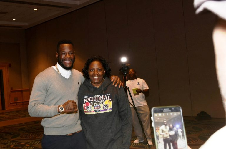 Deontay Wilder poses with a fan. (Solomon Crenshaw Jr. / Alabama NewsCenter)
