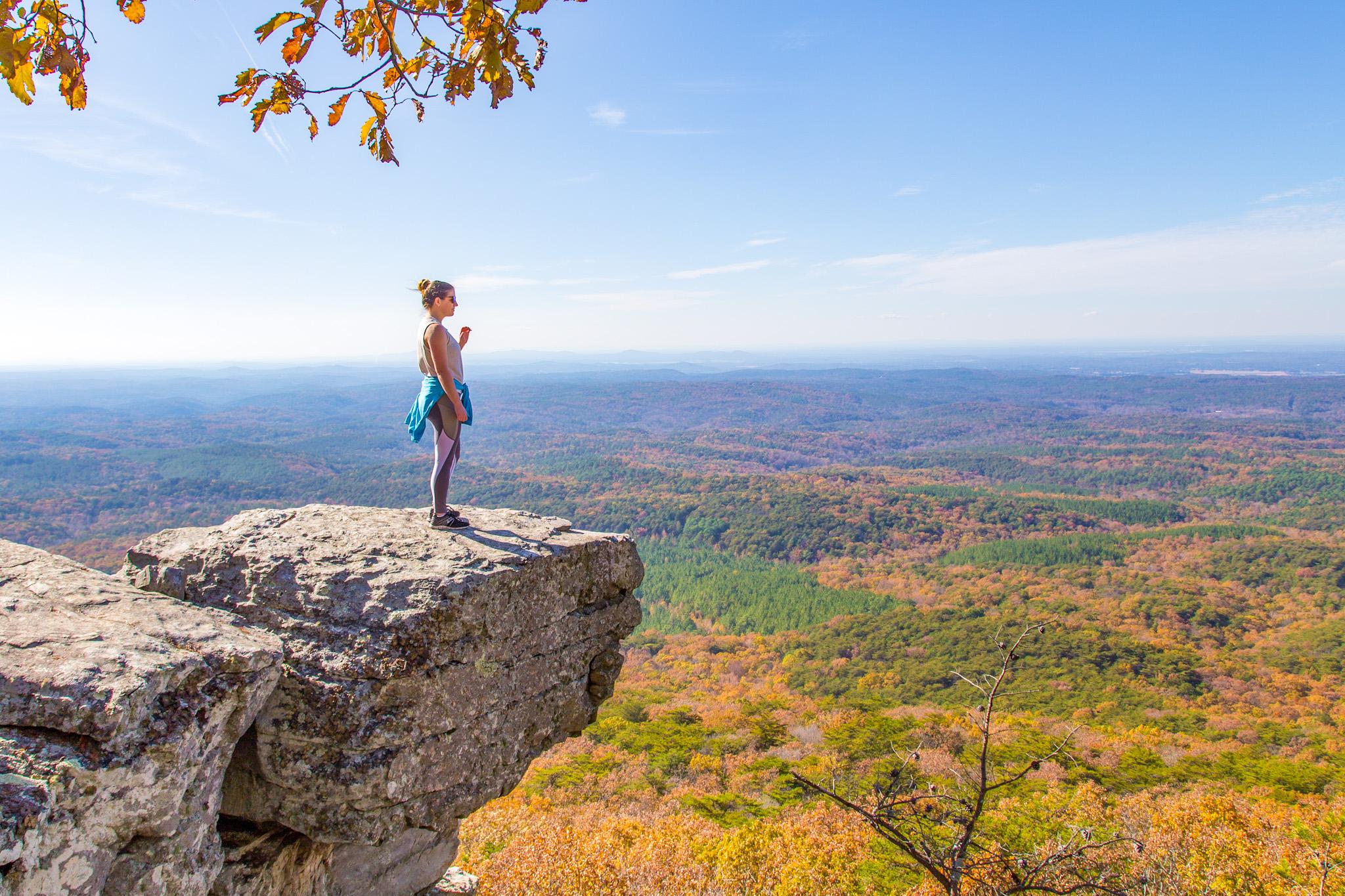 girl on rock overlooking mountain