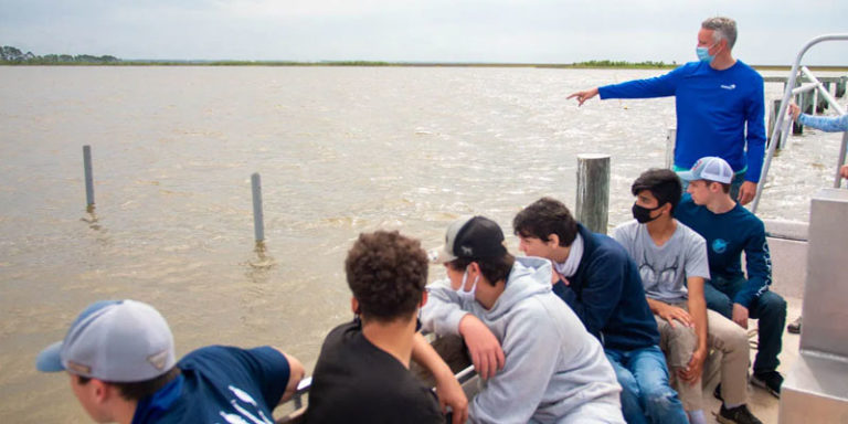 Hands-on project growing oysters in Alabama making high school science fun